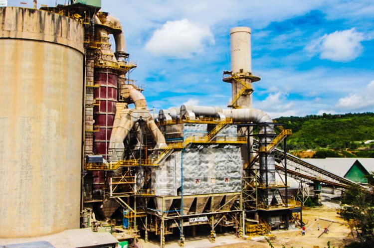 BAGHOUSE. A recent Taiheiyo investment, what used to be the Electrostatic Precipitator (center with inverted pyramid funnels below) of Taiheiyo Cement Philippines, Inc. has been converted to a Bag Filter Dust Collector that now operates at 99.9 percent efficiency.