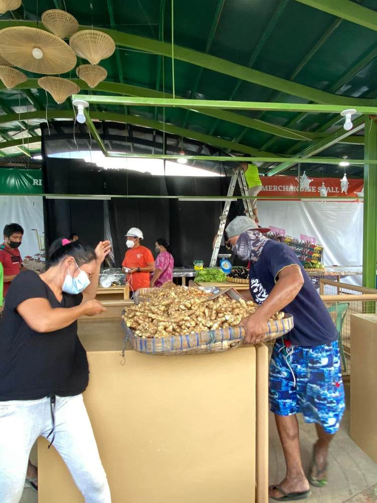 A vendor moves in at the Carbon Bagsakan.