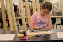 There's tons to do in the Art Studio, like build and fire your own clay piece to take home!