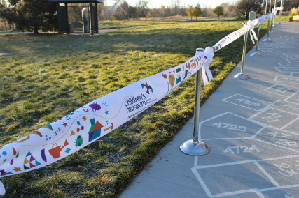 When we say big, we mean big! Our grand reopening ribbon awaits little hands to cut it.