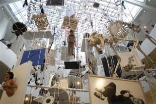 """Installations, part of the retrospective """"Maurizio Cattelan: All"""" by Italian artist Maurizio Cattelan, are seen at the Guggenheim Museum in New York November 4,2011. REUTERS/Shannon Stapleton"""