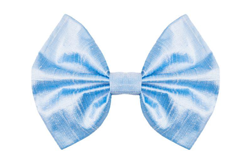 Bow hand-sewn in light blue shantung silk.
