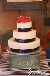 The simple, but elegant cake (atop one of the vintage containers)