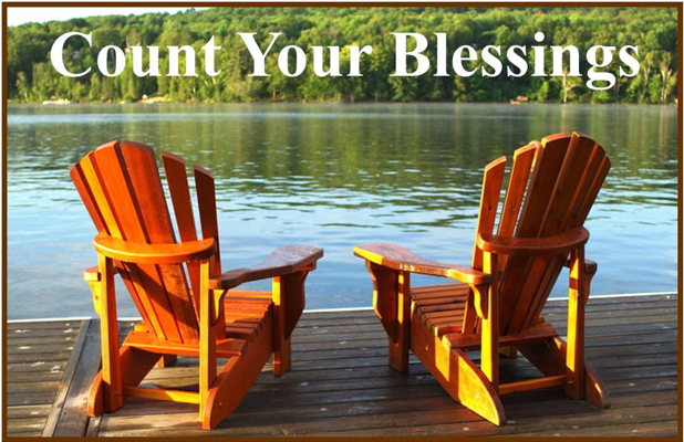 Count Your Blessing view of the lake in two adirondack chairs