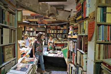 Customers in the Acqua Alta bookshop