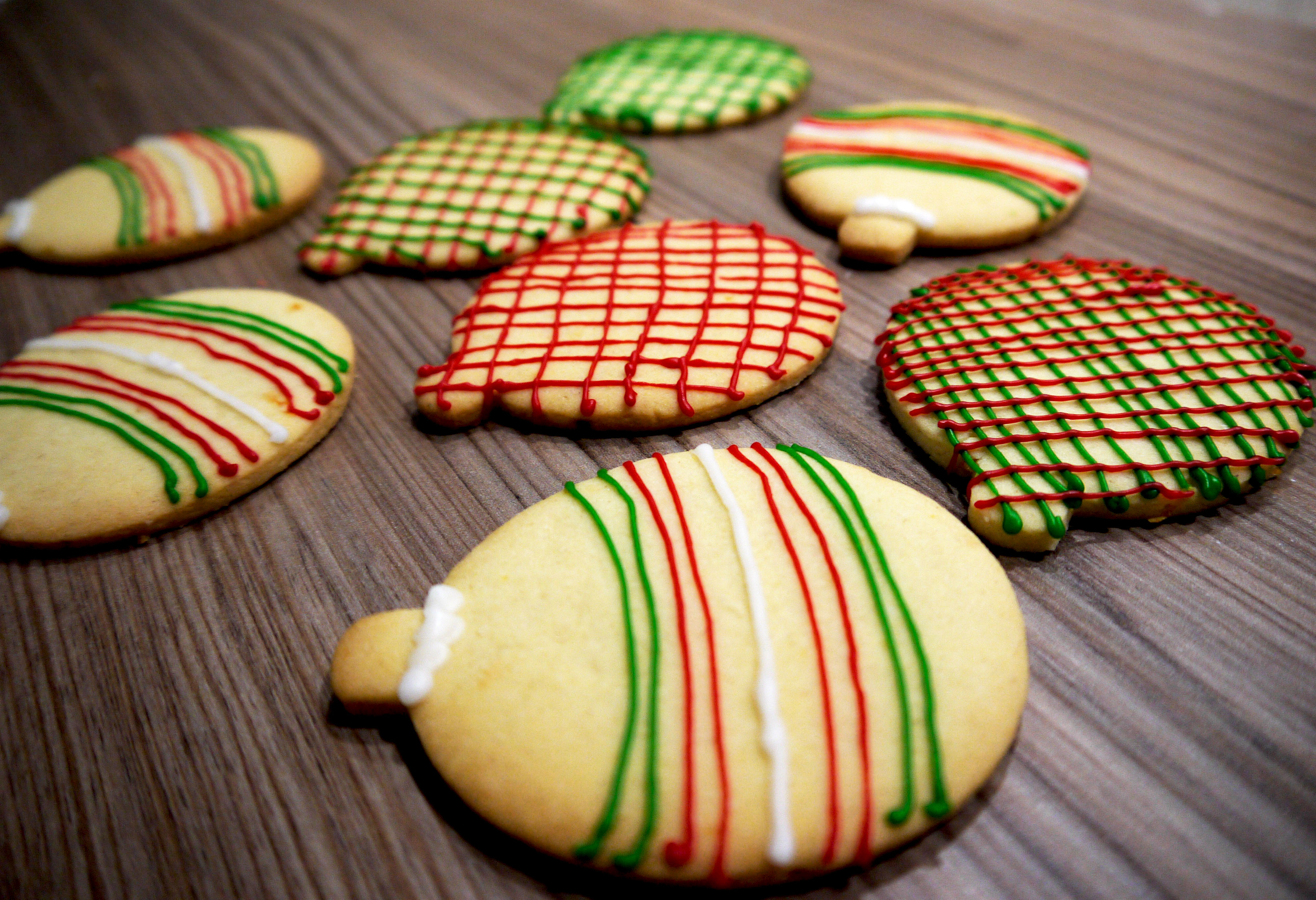 Biscuits decorated as Christmas baubles.