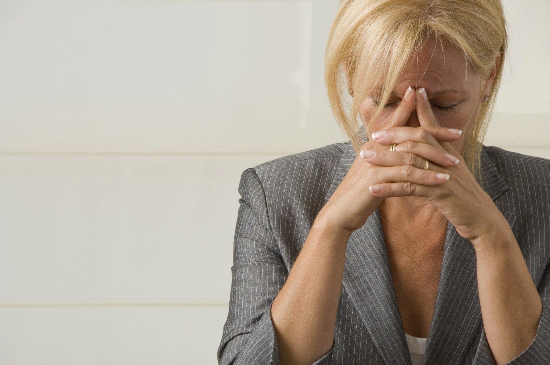 woman head in hands - MyCRA Lawyers can help | 1300 667 218