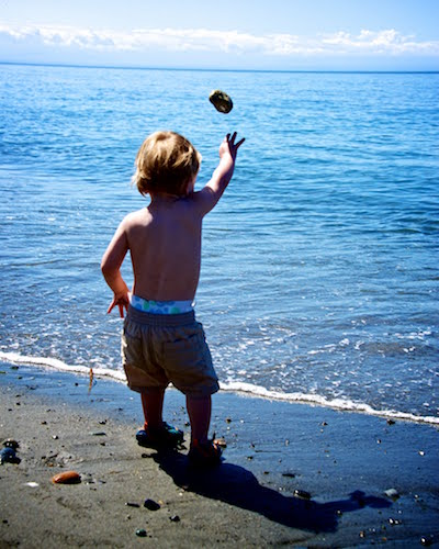 toddler tossing a rock
