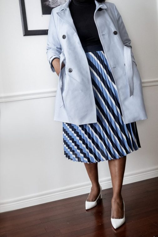 Fresh #plussize Outfit Ideas You Can Wear to Work This Spring. light blue trench coat+ striped pleated skirt.  www.mycurvesandcurls.com  Plus size fashion for women