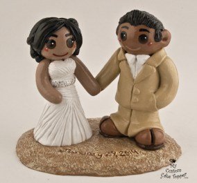 Bride and Groom in the Sand Cake Topper