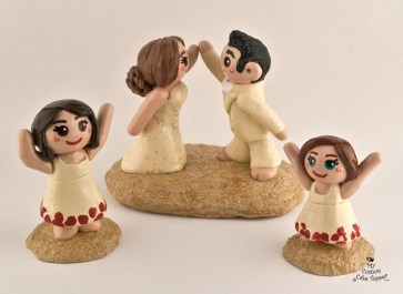 Bride and Groom High Fiving, Daughters Cheering Cake Topper