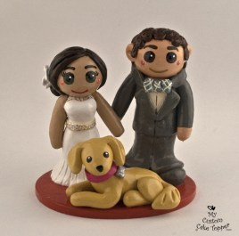 Bride and groom with their gold retriever dog, cake topper