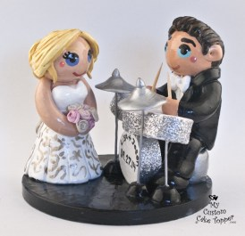 Groom playing on silver drums cake topper