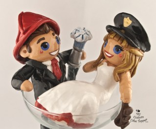 Bride and Groom sitting in a Margarita Glass, Fireman and Police Woman