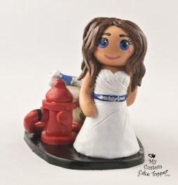 Bride Dragging Groom Fireman Cake Topper