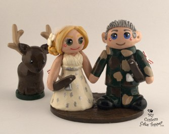 Bride And Groom Hunting With Bow And Arrows Cake Topper