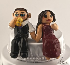 Bride Eating Cake And Groom Drinking Sitting On Cake Topper