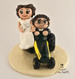 Bride And Groom Riding Tractor Cake Topper