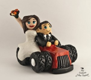 Bride And Groom Riding a Red Tractor Cake Topper
