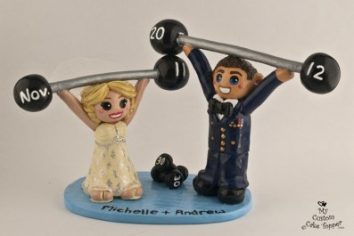 Bride And Groom Lifting Weights In Uniform