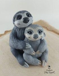 Grey Sloths Cuddling