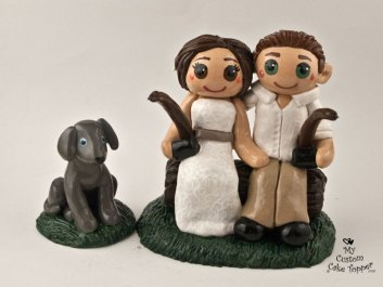 Bride and Groom Fishing off Edge of Cake