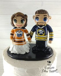 Bride and Groom Hockey Fans in Jerseys Cake Topper