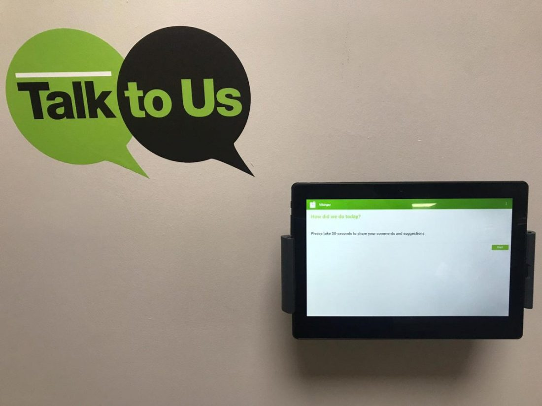 Image of MyCustomerLens feedback tablet and wall graphics