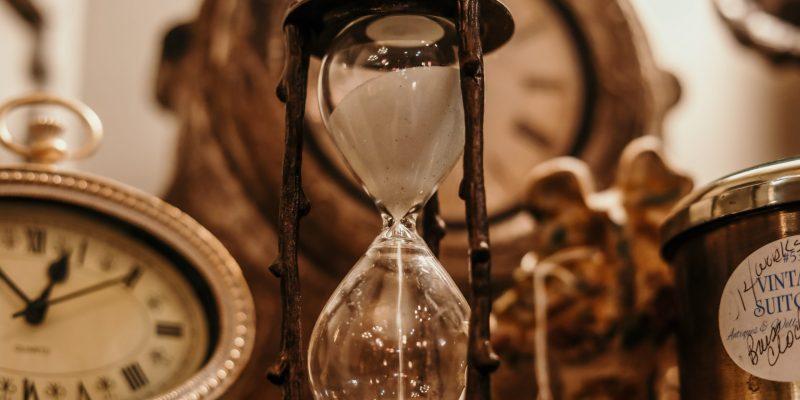 hourglass and clocks, showing found time