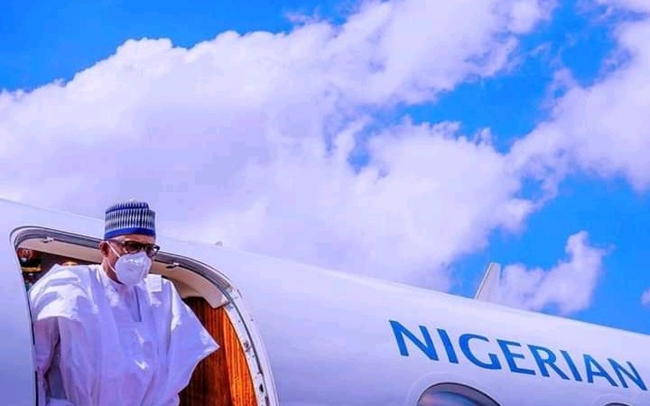 Just In: President Buhari Arrives Bamako on Peace Mission, Wears Facemask For First Time