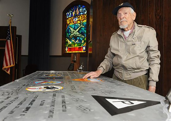 Olen Grant, 91, signed the wing panel from the wing of an old B-17 bomber, the aircraft the 384th Bomber Group flew during World War II.