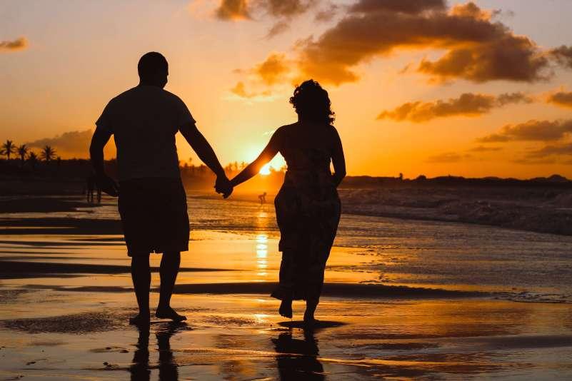 older couple beach sunset