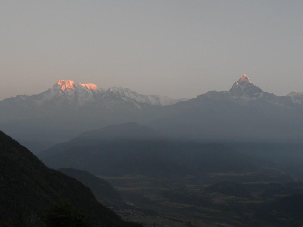 Sun touching the peaks of Annapurna II