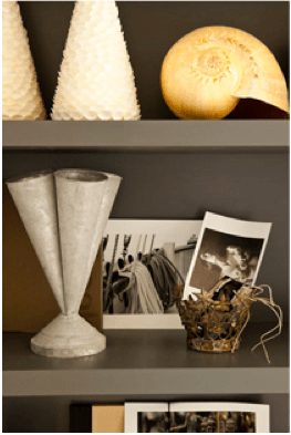 Add some interesting shaped vases, sepia photos, gigantic shell and textured basket.
