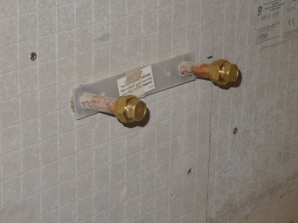 Two shower pipes with 15mm compression blanking ends on them - DIY pipe testing tool