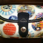 Who wants to win a Disney Dooney & Bourke Wristlet?