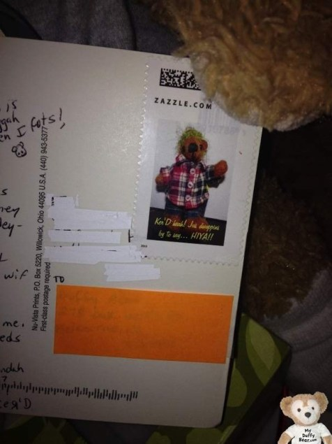 Duffy the Disney Bear shows close up of Kerdunerdunk's Postage Stamp
