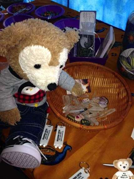 Duffy the Disney Bear reaches into basket for a Crystal