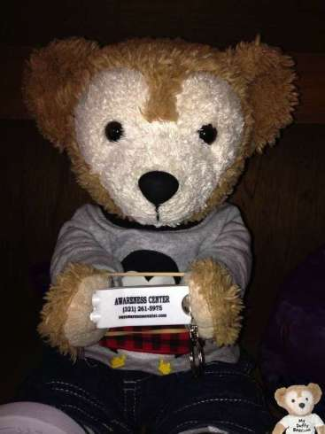 Duffy the Disney Bear gets a close up photo with the free flashlight keychain