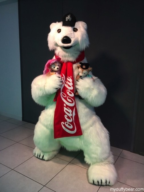 Duffy the Disney Bear gets a hug from the Coca-Cola Polar Bear in Disney Springs.