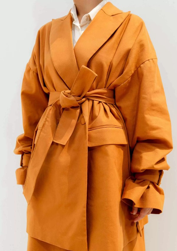 orange blazer with waist belt made from sustainable materials