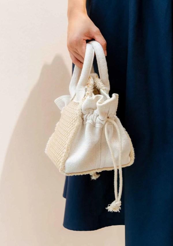 close up of small hand bag made from natural materials