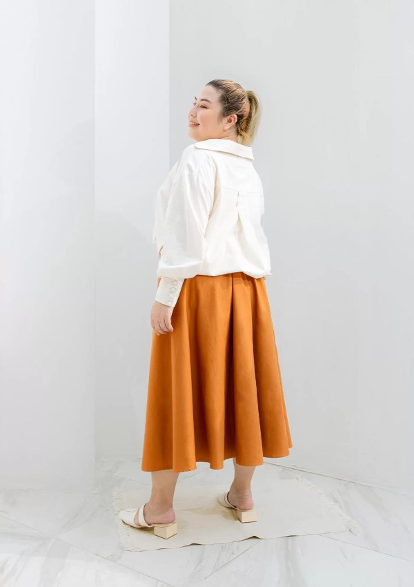 plus size woman wearing orange skirt made from eco materials