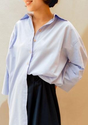 woman with light blue cotton shirt
