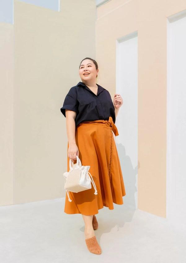Plus size woman wearing orange cotton skirt and shirt