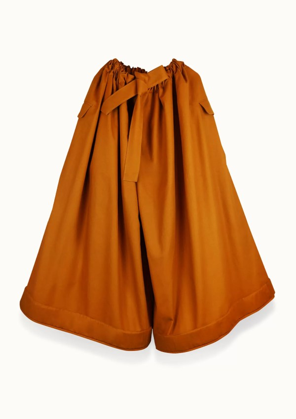 Oversized orange trousers made from sustainable cotton - front