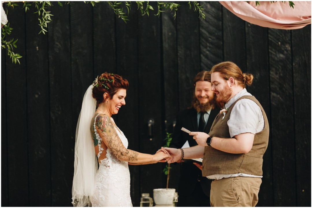 Tatted bride, groom with a man bun, and a black backdrop at the Whitebarn at Middlespring. |Eastern Shore Wedding|
