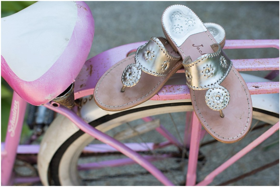 Gold, Jack Roger shoes on a hot pink and white bicycle detail shot. | My Eastern Shore Wedding |