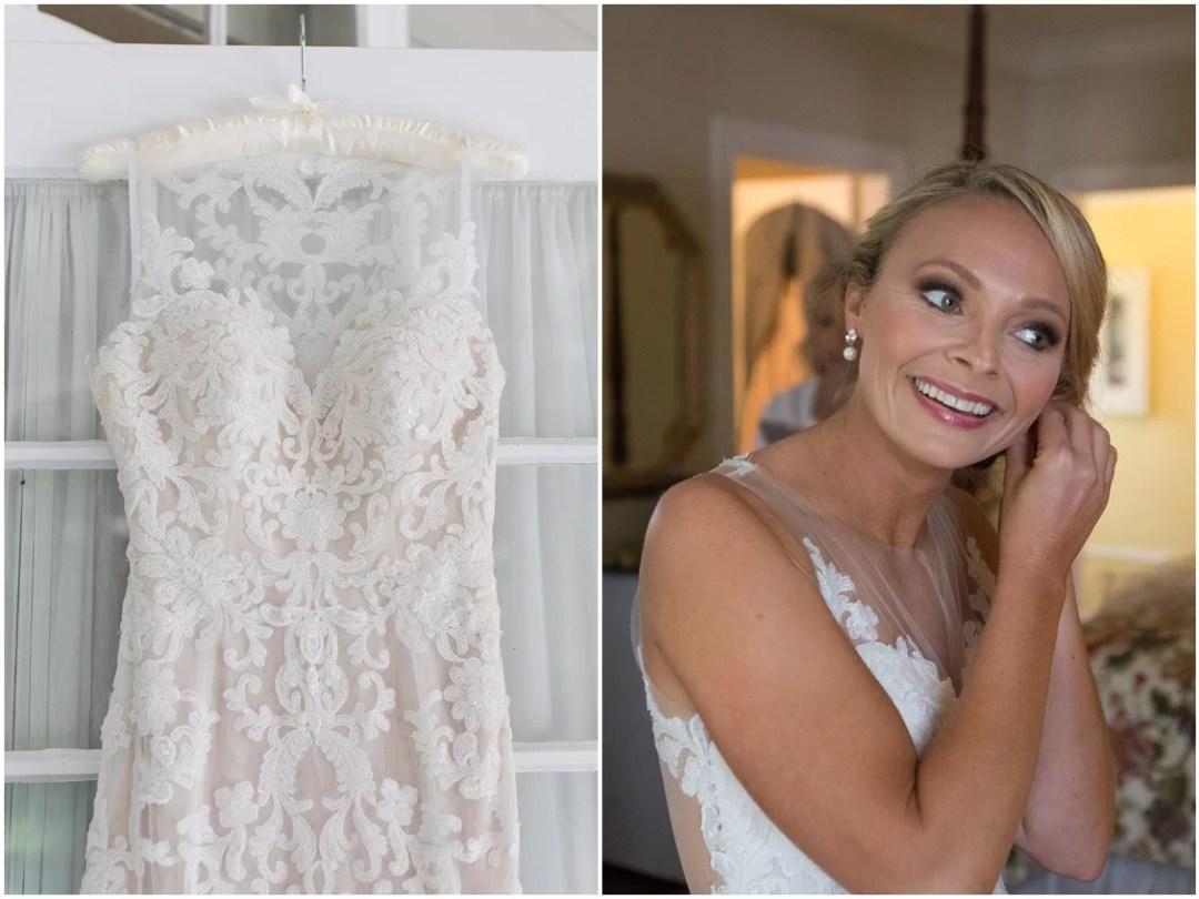 Wedding dress on a hanger, bride putting on earrings. | My Eastern Shore Wedding |