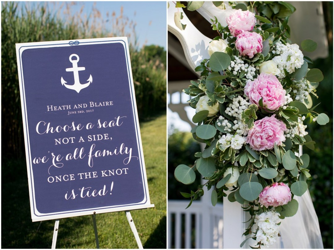 """Nautical """"choose a seat"""" sign and light pink peonies and white floral arrangement. 